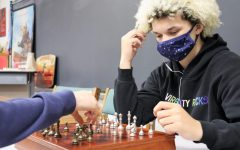 MAKING MOVES.  Playing at an afternoon Chess Club meeting, sophomore Kenneth Chatman looks for his move. Chess Club meets after school on Wednesdays and some days during academy.