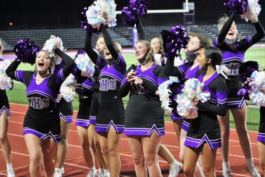 WE SAY WILLIS. Leading the spirit competition at Fire Up the Kats, members of the varsity squad cheers the crowd on. If any student wishes to try out for the 2021-2022 squad, she must return a completed cheer packet by Feb. 19.
