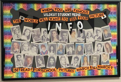 BE READY. A bulletin board created by yearbook staff members advertise upcoming school pictures.
