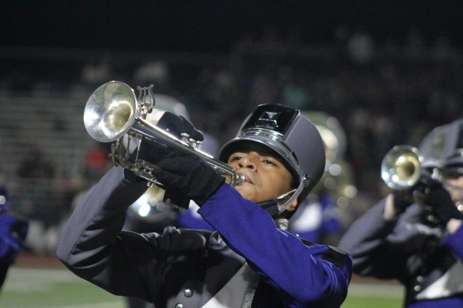 ALL-STATE HONORS. During the halftime performance against Hunstville, junior Angel Garcia plays with the band.  Garcia was named to the 2021 TMEA All-State band after a taped audition process.