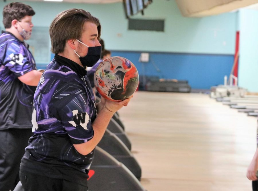 SPARE. Practicing hard, Senior Dawson Asher is ready to throw his ball down the alley.