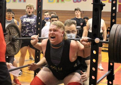GIVING IT HIS ALL. With the state meet in his sights, junior Zach Rogers deadlifts at a qualifying meet. Rogers totalled over 1500 pounds to qualify for the state meet.