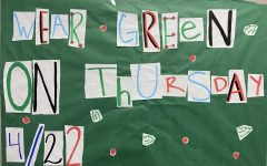 WEAR GREEN. A poster in the hall promotes Earth Day. All students are encouraged to wear green.