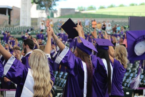 WILDKATS NEVER DIE. Members of the class of 2020 link pinkies during the school song at the 2020 graduation. The 2021 ceremony will also be at The Woodlands Pavillion.