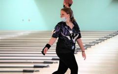 KNOCKING THEM DOWN. After sending the ball down the lane, sophomore Jaslyn Fox hopes for a strike. Fox and the bowling team are headed to state after a great regional competition.