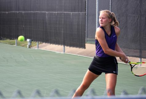 WINNING BACKHAND. At the a tournament senior Megan LeBlanc sets herself up to hit the perfect backhand.