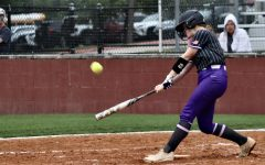 BATTING IN. Freshman Kynlei Chapman hits the ball to try and get on base.