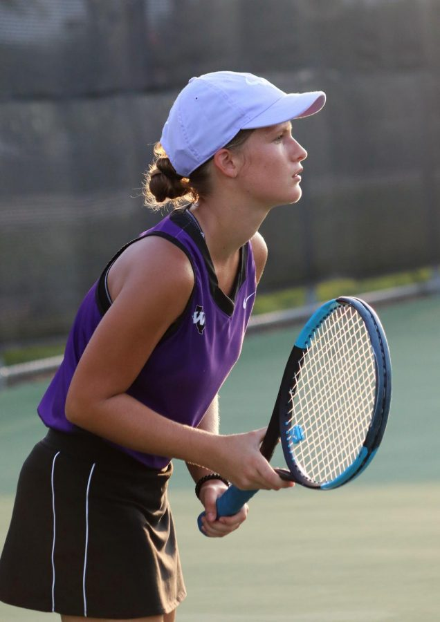 SWEEP. During the tennis match against Huntsville on Tuesday, senior Macey Conaster  waits for the serve. The tennis team won 15 matches before lightning caused delays then cancellation of the match.
