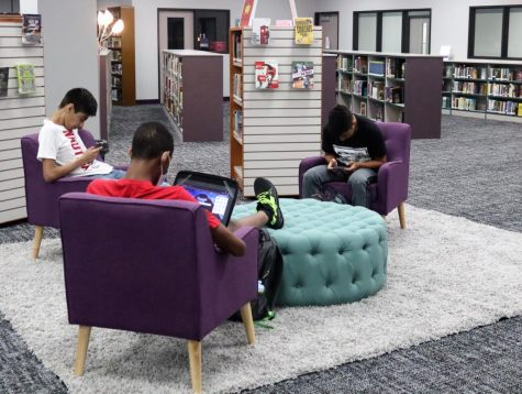 IN OPERATION. Students work while relaxing in the newly furnished area. After the new carpet was installed, the library furniture was rearranged to be the most useful and appealing to students.