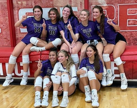 CELEBRATION TIME. After a great night for Wildkat volleyball, members of the varsity team celebrate their victory over Splendora.