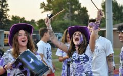 WILDKATS NEVER DIE. At the game against Houston Bellaire, seniors Paige Greeney and Jennifer Talley yell with the PitKru. The PitKru is an organization on campus that boost spirit at football games.