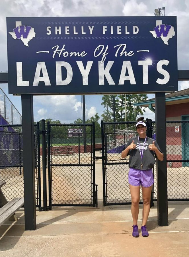 NEW LADYKAT LEADER. Coach Shelby Tinkelpaugh stands at the gates of Shelly Field after being announced the new head coach of the program.