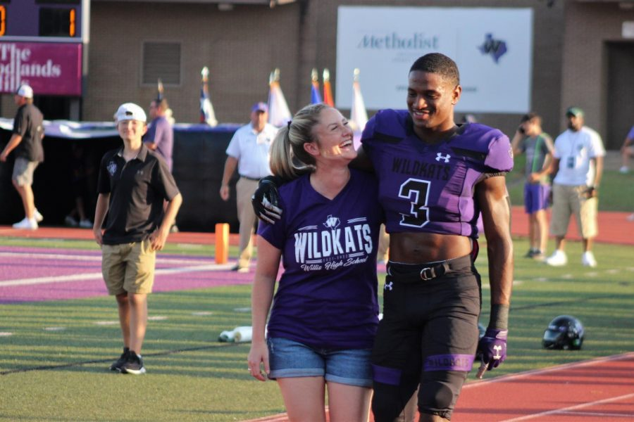 BIG LAUGHS. Teacher appreciation night brings big smiles to the Brittany Knicky and senior Tallis Harrison as they walk the track before the big game. With lots of support from the teachers, it pushed the team towards their 50-28 win!