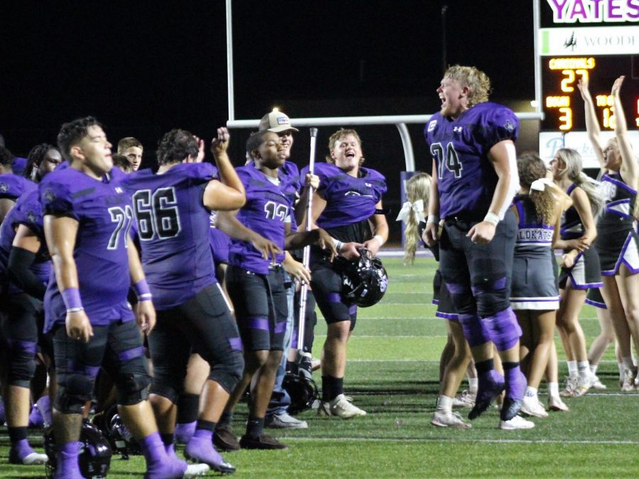 HEY HEY HEY GOODBYE. The varsity football team celebrates after a huge win against Bellaire. With many hard plays behind them, senior Zach Rogers celebrates with a huge leap into the future, hoping for another win.