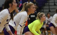 READY FOR ACTION. Waiting for the serve, seniors Reece Edmiston and Taylor Thomas with junior Caroline Woodfill play in the game against rivals Huntsville. The LadyKats won in four sets.