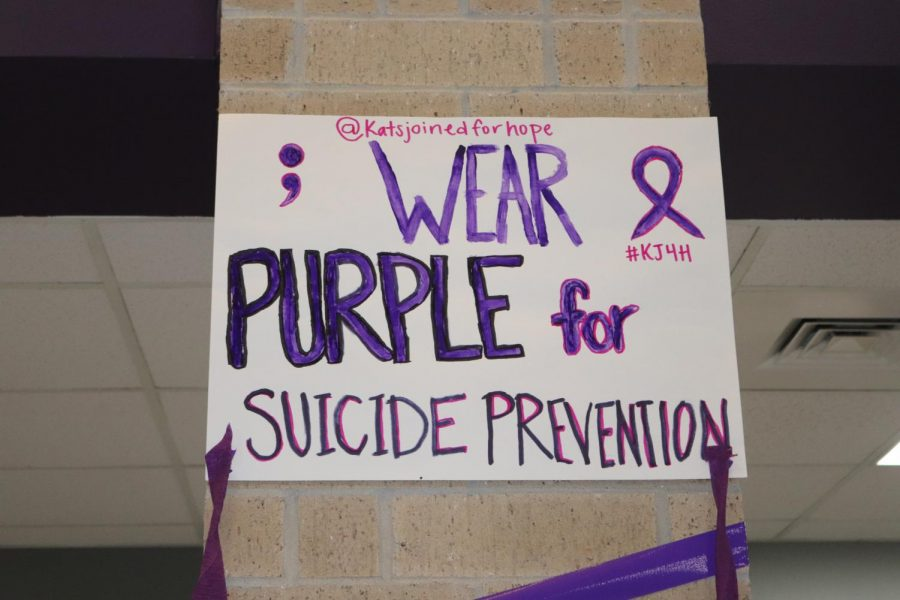 WEAR PURPLE FOR SUICIDE PREVENTION. A poster hangs on the first floor, reminding the school community  to wear purple. The halls were full of messages of hope and purple streamers on National Suicide Prevention Day.