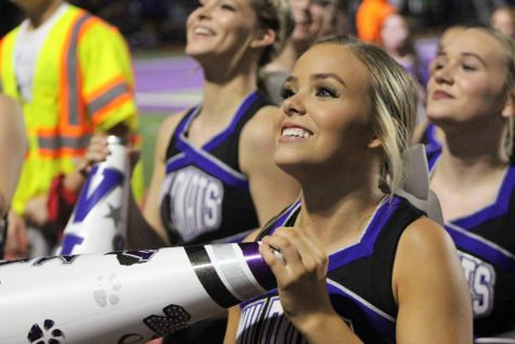 WE SAY WILLIS. Waiting for the student section to echo her cheers, senior cheer captain Mady Feist leads the cheerleaders at the game against Houston Bellaire.