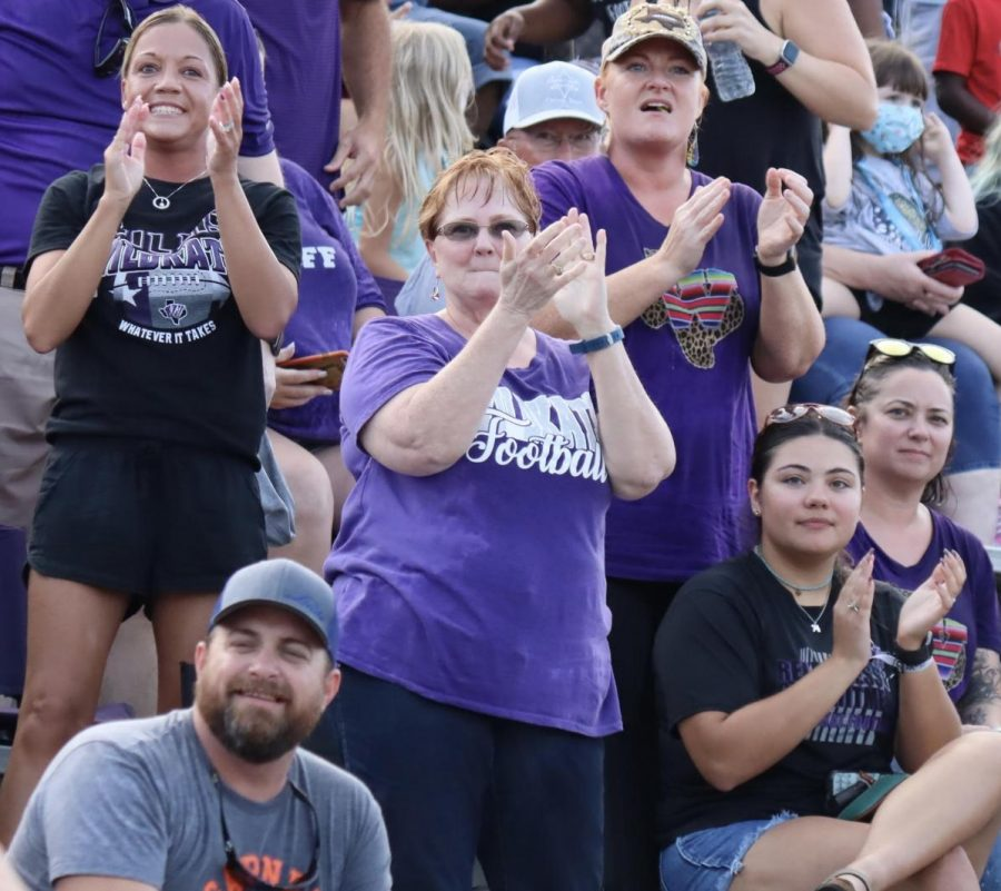 GO ROGERS. From the center of the stands, Trina McAfee cheers for her grandson and the Wildkat football team.  Known as Nana to her grandson senior Zach Rogers and the rest of the team, McAfee's voice can often be heard over all others in the stands.