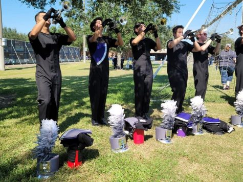 WARMING UP.  Before performing at the Small Town Big Sound contest in Friendswood, members of the trumpet section get ready for the show.