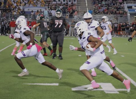 PINK OUT. Playing against the Woodlands Highlanders, the Wildkats wore pink for breast cancer awareness month.