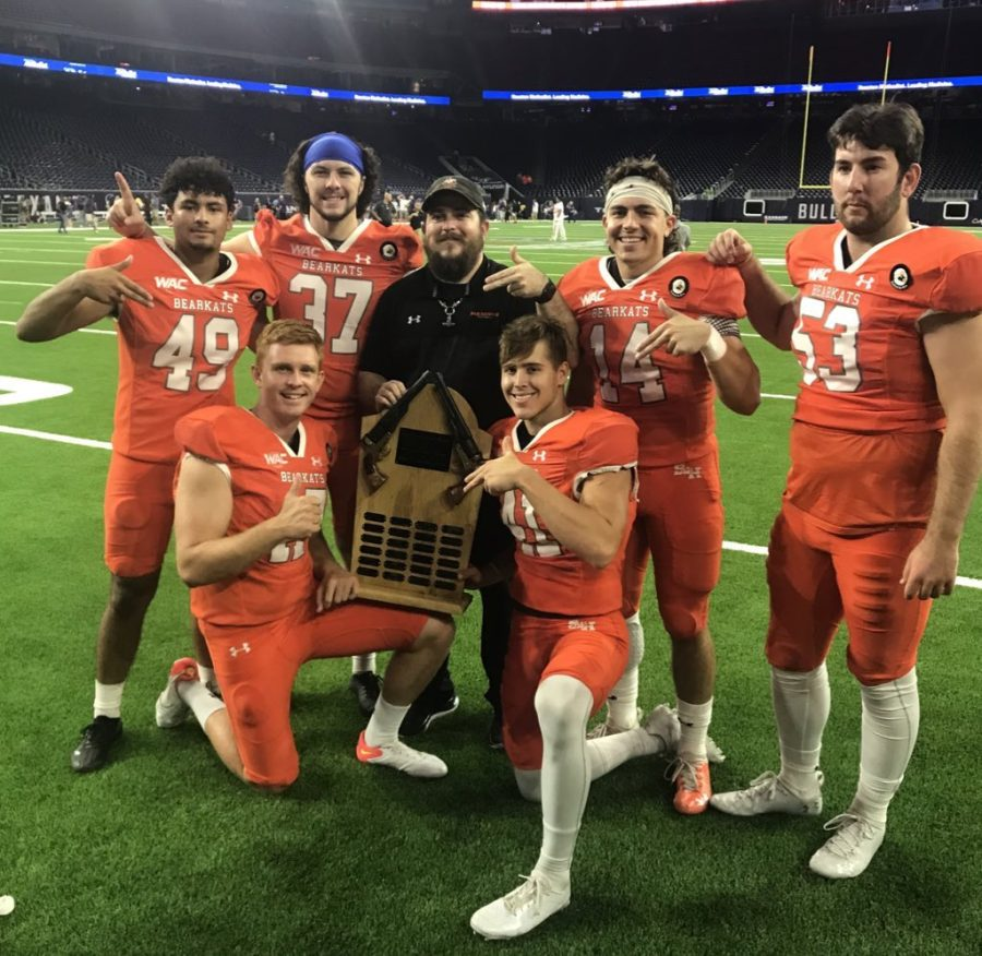 CHAMPIONS OF THE BATTLE. After winning the Battle of the Piney Woods, Wildkat alumni Christian Pavon (49) joins his Bearkat family in celebrating the victory.