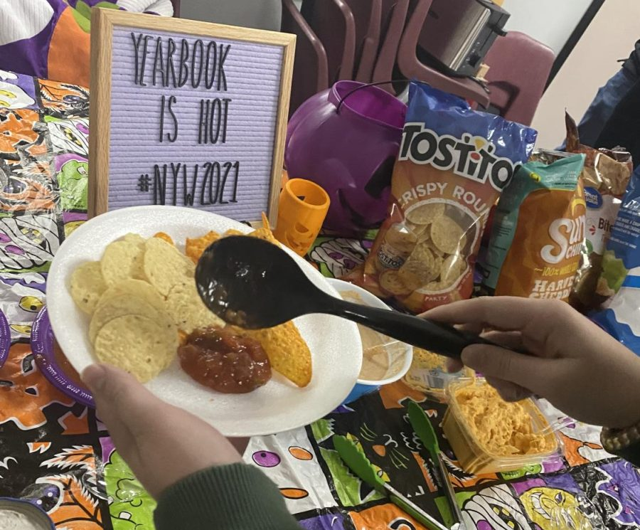 HOT STUFF. Members of the yearbook staff celebrate National Yearbook Week with chips and dip on Wednesday.