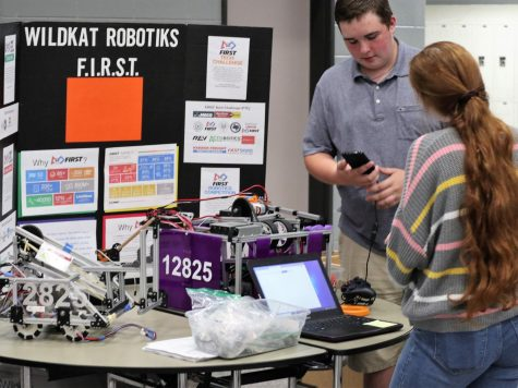 READY FOR ROBOTICS. At freshman parent night, junior James Rogers and senior Kendall Cobb set up to recruit possible new members.