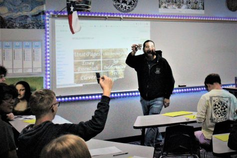 NO MAGIC NEEDED. Teaching his class how to be successful in his class with a cards, AP World History teacher Michael Robinson shows his card to the class. For many of the students, this is the start of college level classes in their high school career.