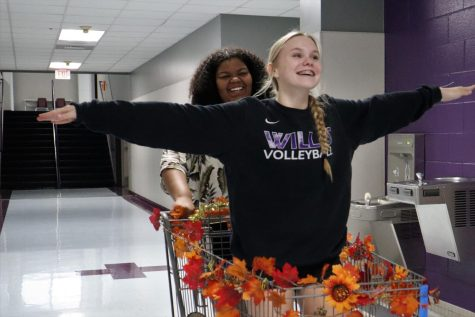 IM ON TOP OF THE WORLD. Using her basket to carry sophomore Grace Wilder to class, senior Avari Ford takes advantage of her anything but a pack pack prop.