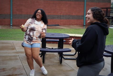 DANCE IN THE RAIN. A small shower during lunch was the perfect time for junior Yabi Paulino and senior Janice Maldonado to play in the rain.